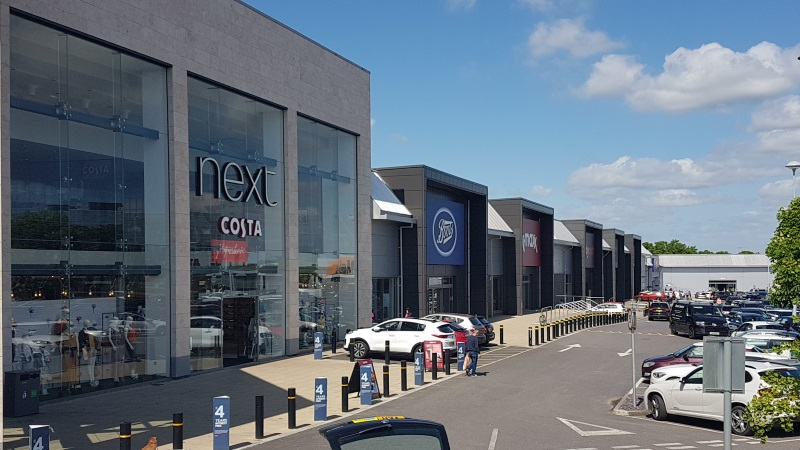 Next and Boots stores at County Oak Retail Park